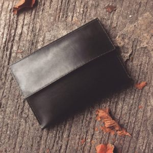 structured basic black leather clutch